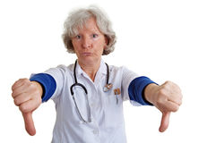 Female doctor holding thumbs down Stock Photography
