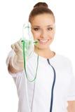 Female doctor holding up oxygen mask stock photo