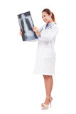 Female doctor holding x-ray picture Stock Photography