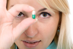Female-doctor holds capsule Royalty Free Stock Photo