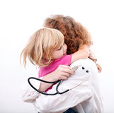 Female doctor hugging little patient girl Royalty Free Stock Photography