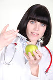 Female doctor injecting apple Royalty Free Stock Images