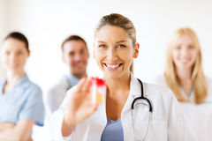Female doctor with jar of capsules Stock Images