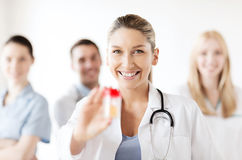 Female doctor with jar of capsules Royalty Free Stock Image