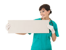 Female doctor keeping  blank sign Stock Photography