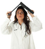 Female doctor keeping laptop on head Stock Photos