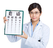 Female doctor keeping optometry chart Royalty Free Stock Photography