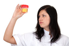 Female doctor keeping urine to analysis Royalty Free Stock Photography