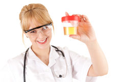 Female doctor keeping urine to analysis Stock Photos