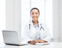 Female doctor with laptop pc Stock Photos