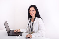 Female doctor with laptop Royalty Free Stock Photos