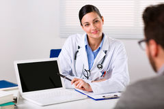 Female doctor listening intently to a patient royalty free stock photography
