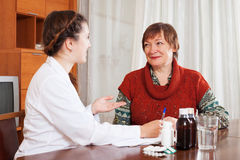 Female doctor listening mature woman Royalty Free Stock Photography