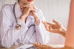Female doctor listening to depressed patient talking about health problem royalty free stock photos