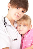 Female doctor with little patient Stock Photography