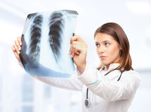 Female Doctor Looking At The X-ray Stock Photo