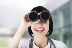 Female doctor looking through the binocular Royalty Free Stock Images