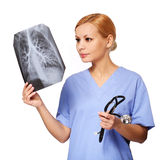 Female doctor looking at chest X-ray isolated. On white royalty free stock photography