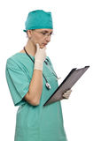 Female doctor looking at clipboard Royalty Free Stock Image