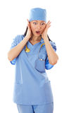 Female doctor looking scared. Stock Image