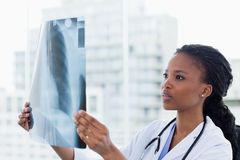 Female doctor looking at a set of X-rays Stock Photo
