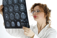 Female doctor looking at tomography brain Royalty Free Stock Photography