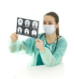 Female doctor looking at tomography brain Royalty Free Stock Image
