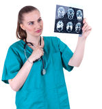 Female doctor looking at tomography brain Royalty Free Stock Photos