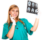Female doctor looking at tomography brain Royalty Free Stock Images