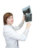 Female doctor looking at an x-ray Royalty Free Stock Photos