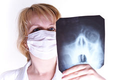 Female doctor looking at a x-ray Stock Image