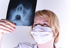 Female doctor looking at a x-ray Stock Photography