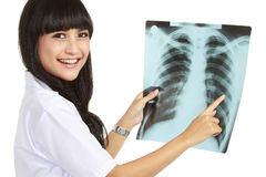 Female doctor Looking At X-Ray Royalty Free Stock Photography