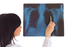 Female doctor looking at x-ray Stock Images
