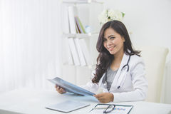Female doctor looking at an x-ray Stock Image
