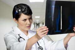 Female doctor looking at an x-ray in a hospital Stock Image