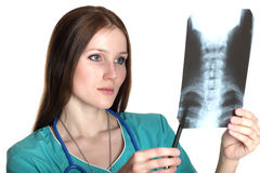 Female doctor looking at xray picture Stock Photo