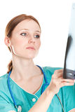 Female doctor looking at xray picture Royalty Free Stock Photo