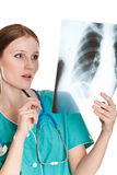 Female doctor looking at the xray picture Royalty Free Stock Photography