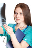 Female doctor looking at the xray picture Royalty Free Stock Photos