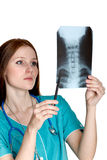 Female doctor looking at the xray picture Stock Photos