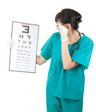 Female doctor lookng at optometry chart Stock Photo