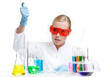 Female doctor makes an experiment Stock Images