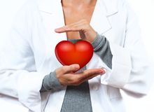 Female Doctor is making heart shape. Medical Concept. Female Doctor is making heart shape. Medical Insurance Concept stock images