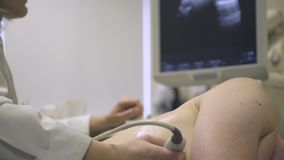 Female doctor making ultrasonography to patient stock footage