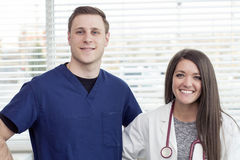 Female Doctor and male nurse smiling in office stock photo