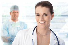 Female doctor and male surgeon, portrait. Smiling Royalty Free Stock Images