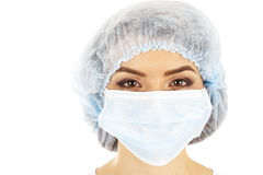 Female doctor in a mask closeup. Stock Image