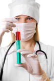 Female doctor in a mask and a syringe in hands Stock Image