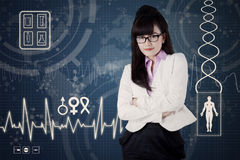 Female doctor with medical background 1 Royalty Free Stock Images